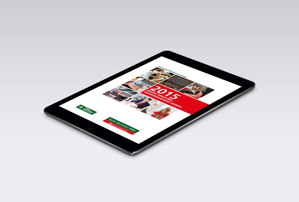 Tablet z widokiem okładki Raportu CSR